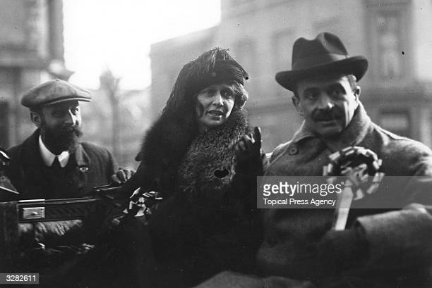 Americanborn British politician Nancy Witcher Langhorne Viscountess Astor together with her husband Waldorf Astor 2nd Viscount Astor campaigning as...