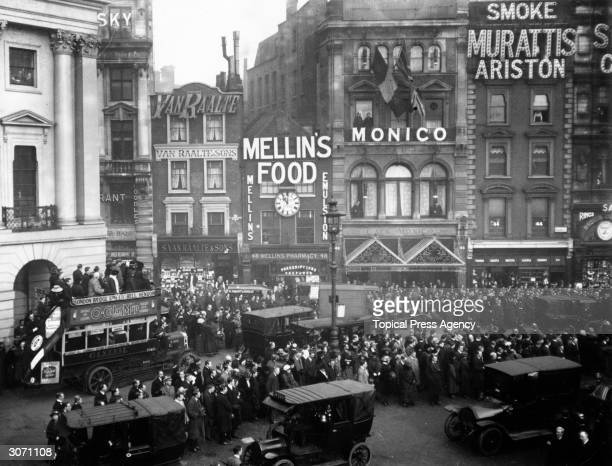 Crowds celebrating the anniversary of the armistice at Piccadilly Circus, London.