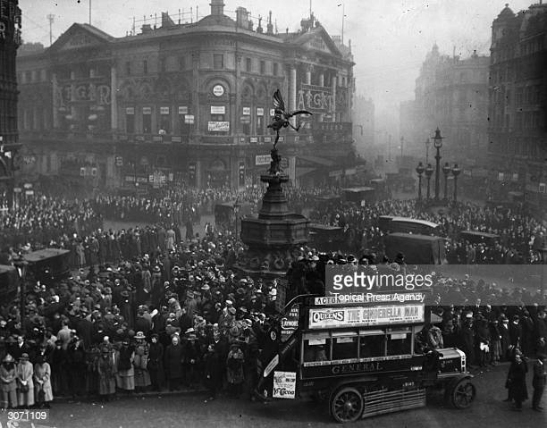 Crowds celebrating the anniversary of the armistice at Piccadilly Circus London