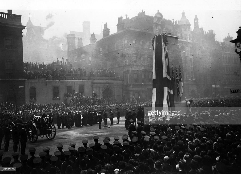 King George V presses button unveiling the cenotaph in Whitehall a gun carriage holds body of The Unknown Soldier to be buried in Westminster Abbey.