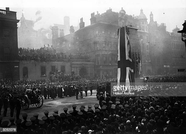 King George V presses button unveiling the cenotaph in Whitehall a gun carriage holds body of The Unknown Soldier to be buried in Westminster Abbey