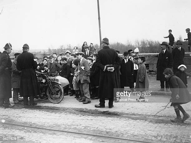 Policemen hold up a motorcyclist in Dublin during a period of nationalist unrest