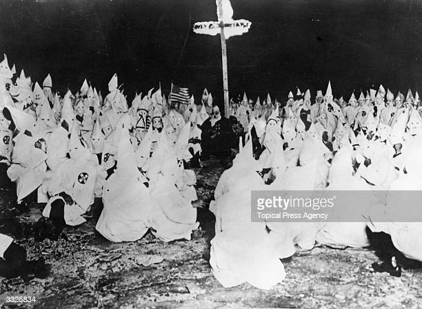 A midnight meeting of the American white supremicist movement the Ku Klux Klan