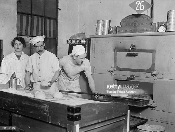 Bakers baking bread in an electric oven