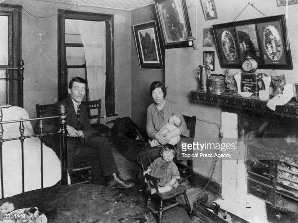A family in their room in a Lisburn Street tenement house in the Bethnal Green east London slum area