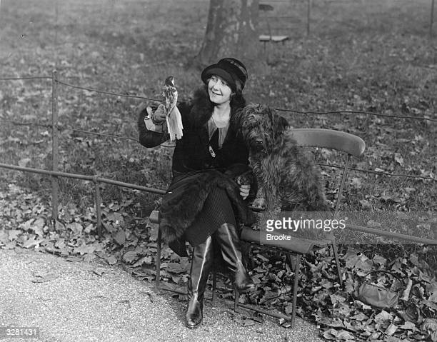 Ivy Tresmand in Hyde Park London with her pet Russian Wolfhound and parrot She is also wearing Russian boots