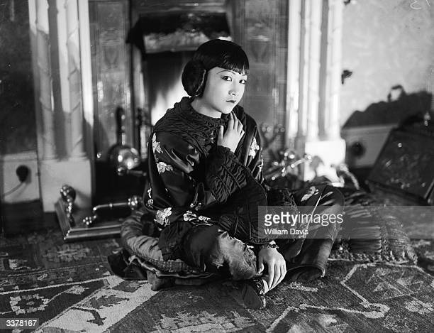 AmericanChinese actress Anna May Wong sitting on the floor wearing a wrap