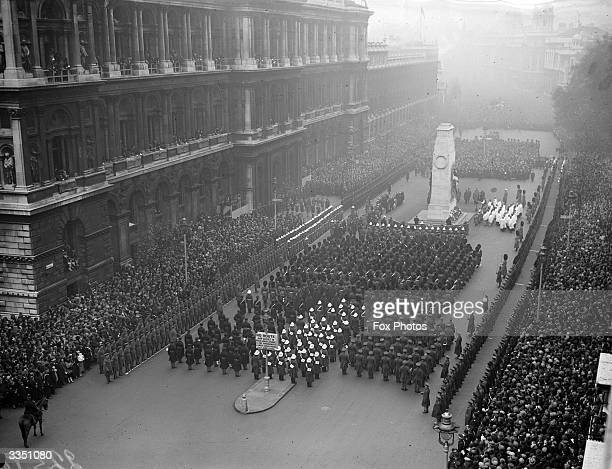 Crowds line the square to watch a military ceremony commemorating Armistice Day around the Cenotaph in Whitehall London