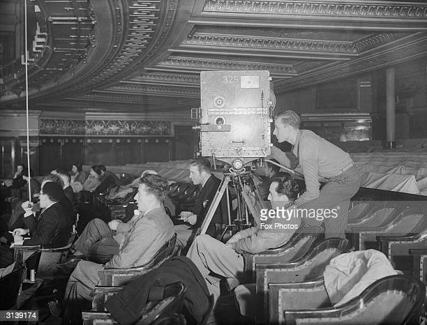 People in the stalls of the Drury Lane theatre in London watching the filming of the ballet 'Escape Me Never'