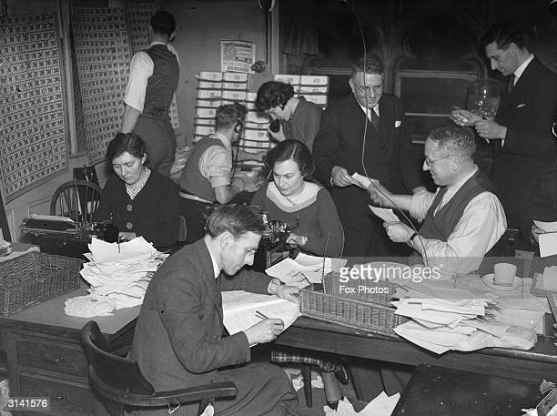 Journalists at Reuters Press Agency receive results of the General Election