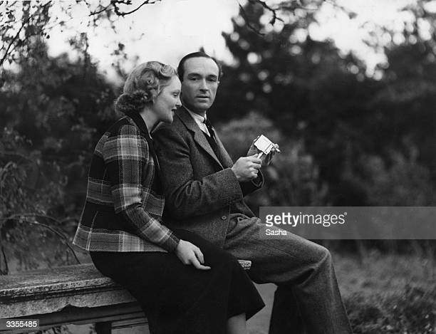 British stage and screen actress Joan Barry with her husband Henry Tiarks in the garden at 'Kingsmoor' Suningdale