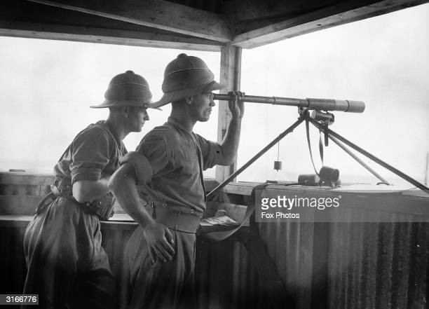 Members of the 2nd Battalion of the former East Kent Regiment informally known as Buffs keep watch from a lookout post in Acre The town was part of...