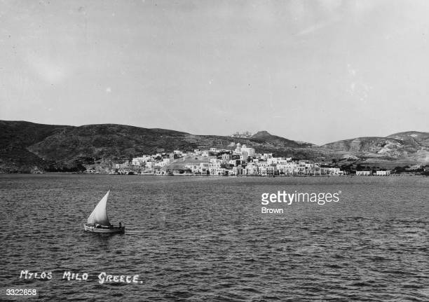 A boat sailing off the coast of the island of Milos one of the Cyclades Islands in the Aegean Sea southeastern Greece