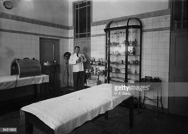 Arsenal football club trainer Tom Whittaker in his state of the art medical room where players receive treatment