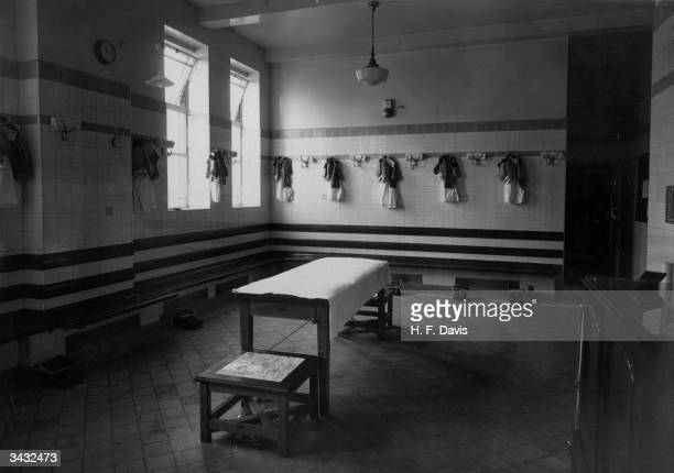 The home side changing room at Highbury with Arsenal kit hanging on pegs ready for a match