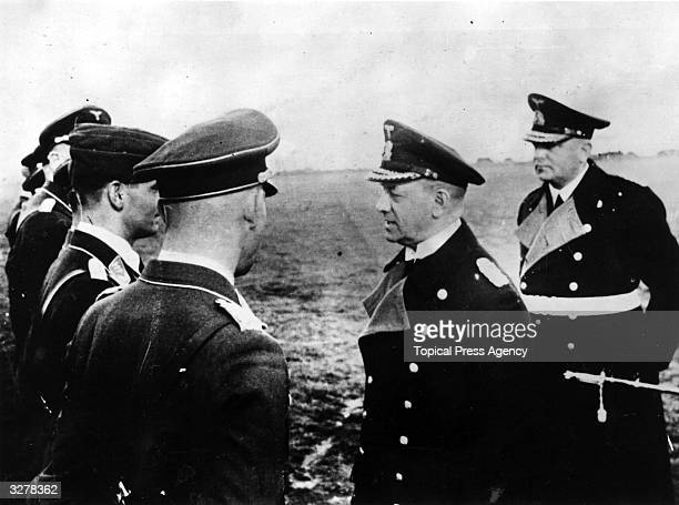 Admiral Erich Raeder talks to Captain Rosenthal and other pilots who recently failed in their attack on the British naval fleet in the Firth of Forth