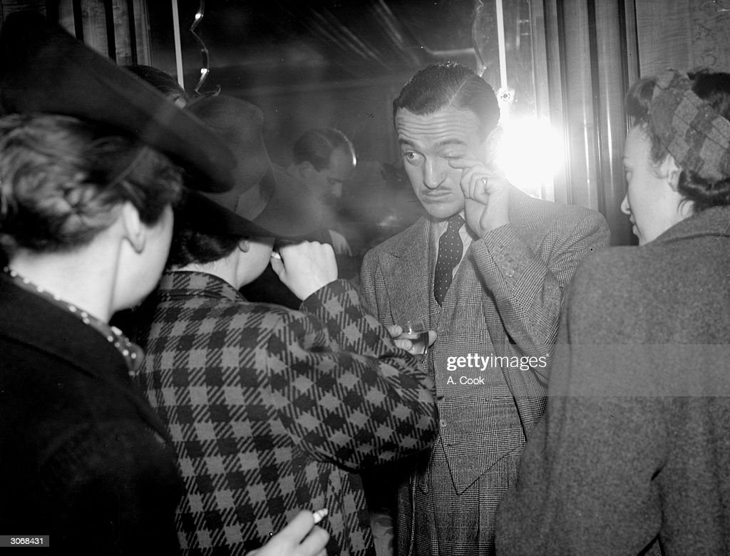 Hollywood actor David Niven (1909 - 1983) leaves a reception at the Odeon cinema.