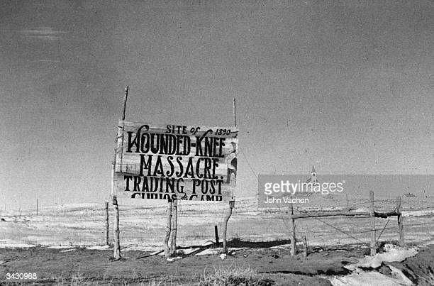 A sign at the site of the Wounded Knee Massacre South Dakota where 250 American Indians were killed in 1890