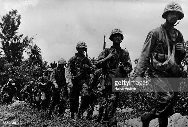 Troops advance on Bougainville Island against the Japanese occupation troops.