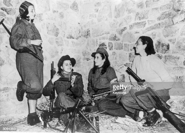 A quartet of Italian antiFascist women patriots who are helping the Allied forces on the Castelluccio front are shown relaxing while awaiting orders...