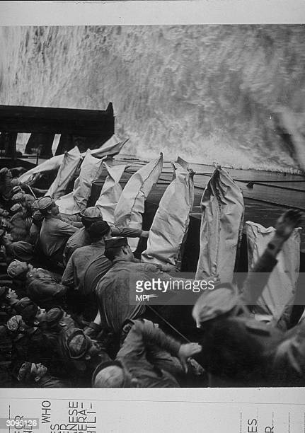 Burial at sea aboard the USS Intrepid Bodies wrapped in bags are held ready to be dropped over the side into the sea