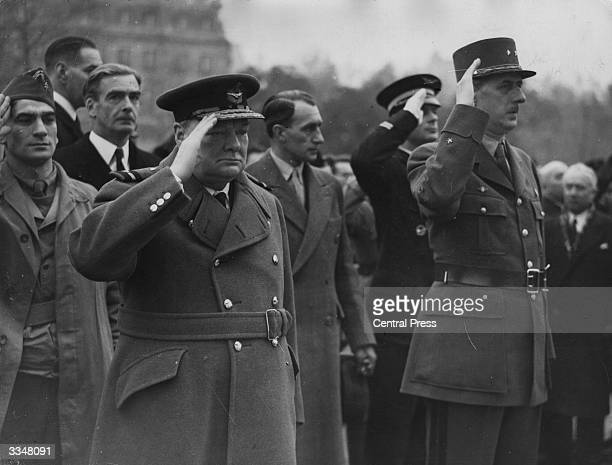 In Airforce uniform Prime Minister Winston Churchill and French commander General de Gaulle stand at the Tomb of the Unknown Soldier Paris during the...