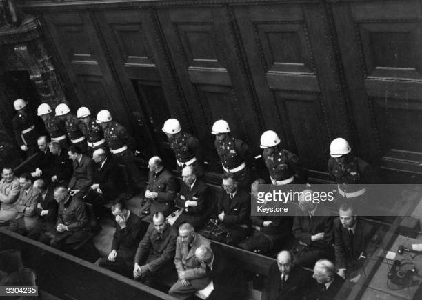 Nazi leader Hermann Goering and other accused war criminals being guarded by US Military Police during the Nuremberg War Crime Trials