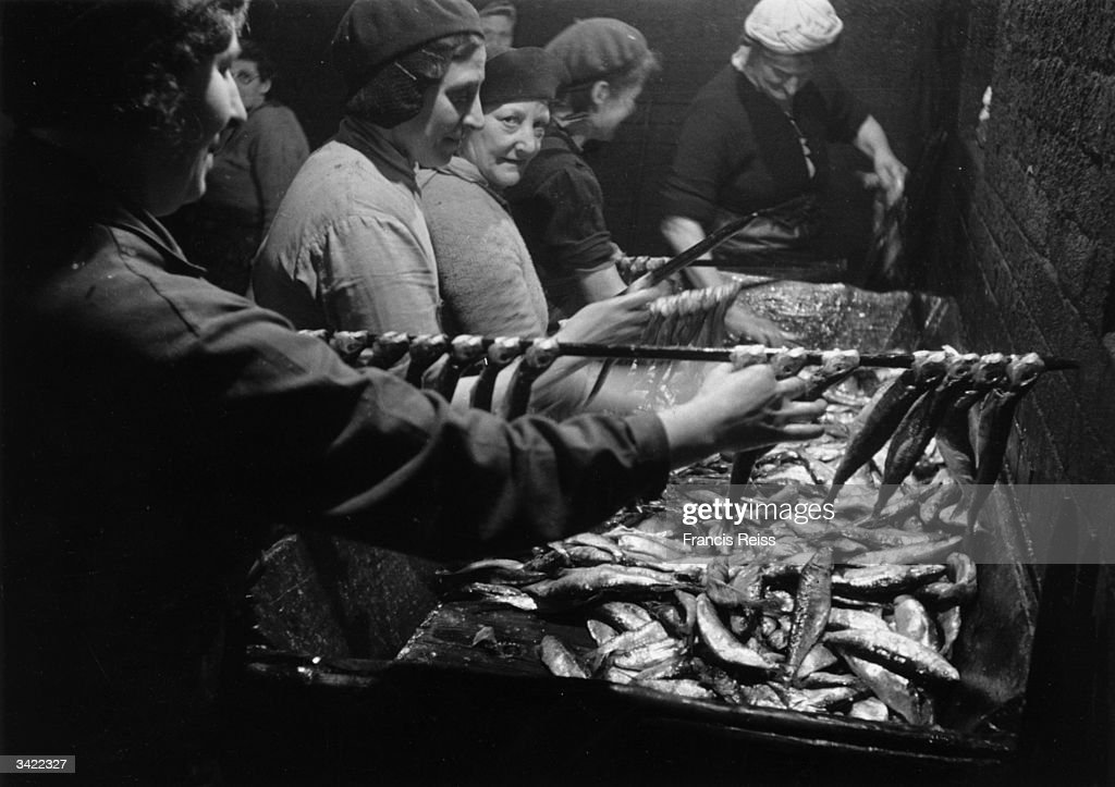 Women sorting and preparing the herring catch at Yarmouth. Original Publication: Picture Post - 3027 - Yarmouth Herring Girls - unpub.