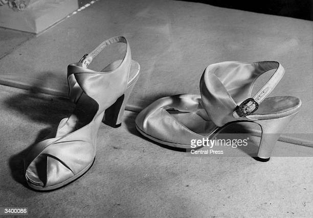 A closeup of the wedding shoes of Princess Elizabeth 'Ivory Duchess' satin selflined sandals designed by Rayne The buckles are silver studded with...