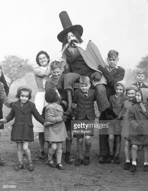 The staff and children of the Aldersbrook Children's Home, Wanstead, celebrating Guy Fawkes Day.