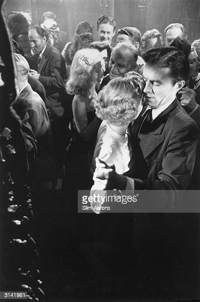 James Mason as Larry Quinada and Barbara Bel Geddes as Leonora Eames dancing together in a scene from 'Caught' a film noir directed by Max Olphus