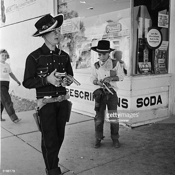 Boys play at western-style gunfighting at the Helldorado in Tombstone, Arizona.