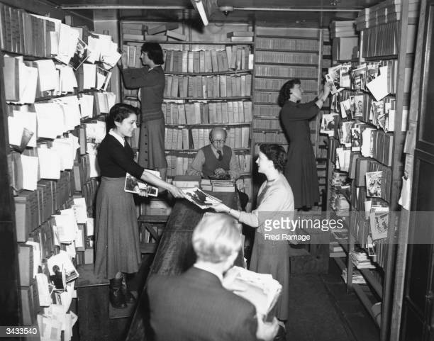 Busy scene in Keystone Press Agency picture library which stores 100,000 negatives and a large collection of prints.