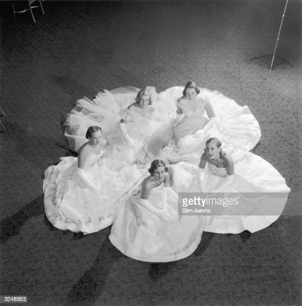 Five members of the Debutante Cotillion rehearse for the Christmas Ball at the Waldorf Astoria Hotel in New York. Clockwise from the bottom: Ann...