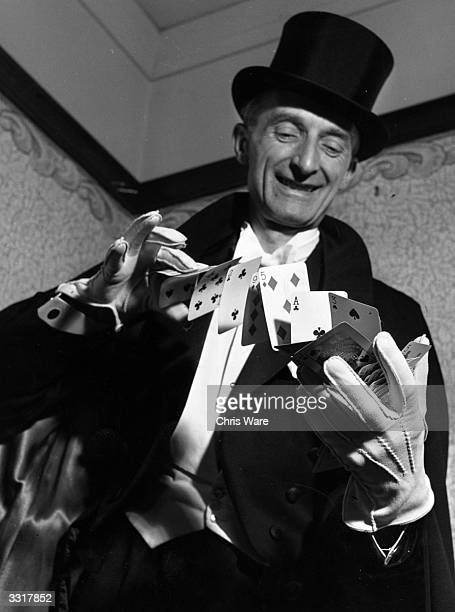 Magician Geoffrey Buckingham demonstrating the 'flourish' in which the playing cards are shot from one hand to another