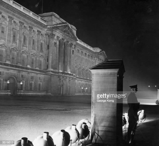 Buckingham Palace, London, floodlit at night.