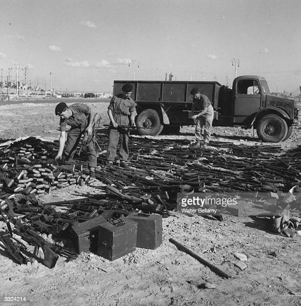 British troops with captured weapons during the Suez Crisis