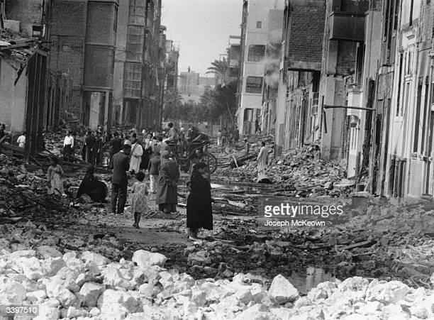 Inhabitants of Port Said in the damaged streets after a bombardment during the Suez Crisis Original Publication Picture Post 8735 Death Wore A...