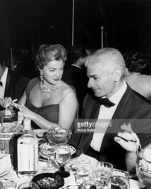Actors Jeff Chandler and Esther Williams were guests of honor at the WAIF Imperial Ball held at the Cocoanut Grove Los Angeles California