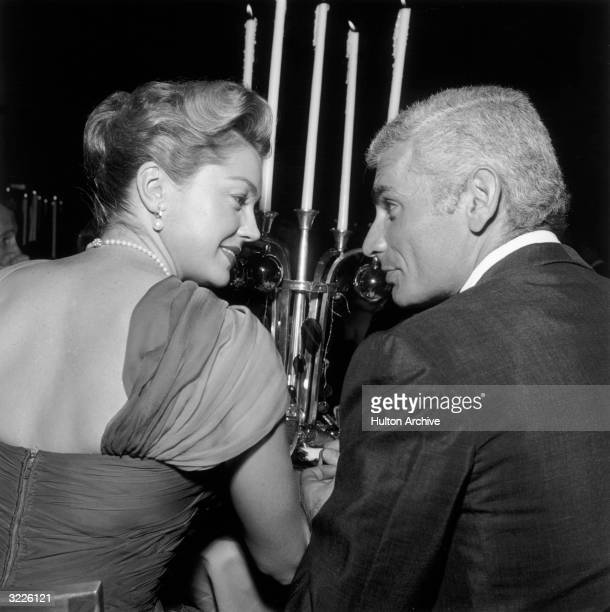 American actors Esther Williams and Jeff Chandler face each other while sitting together during an WAIF Imperial Ball, Beverly Hilton Hotel, Beverly...