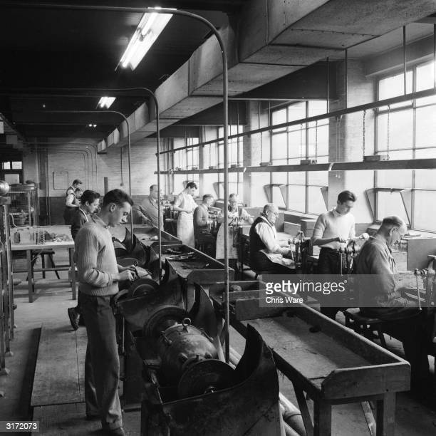 Workers assembling and finishing knives at a Sheffield Steelworks