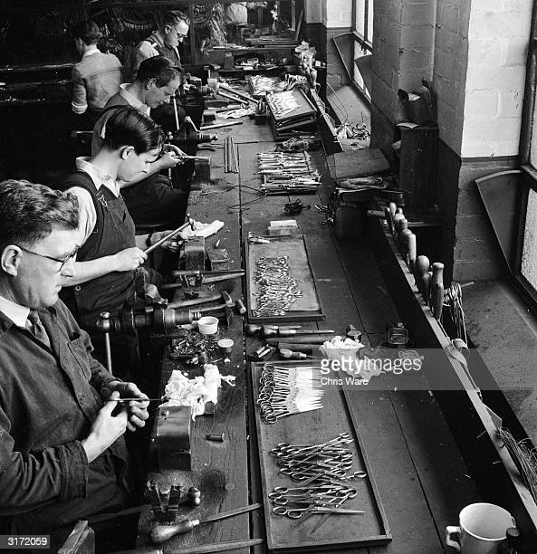 Workers at a Sheffield steel factory matching pairs of scissor blades The scissors have to cut smoothly along the whole length of the blade so it is...