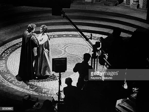 American actor Charlton Heston and Italian film star Sophia Loren during filming of the romantic epic 'El Cid' directed by Anthony Mann