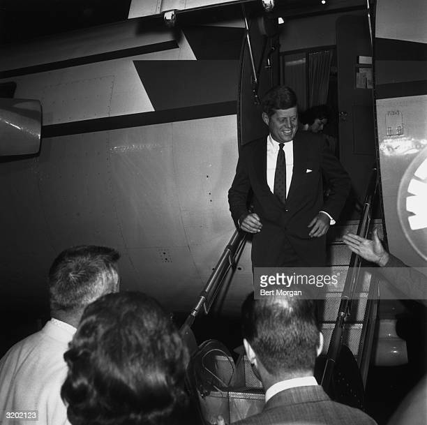 EXCLUSIVE President elect John F Kennedy being greeted by a crowd as he walks down the stairs of an airplane on his arrival at the airport at West...