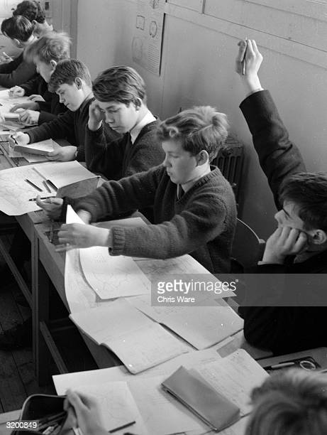 Boys studying maps in a geography lesson at Sheephatch School in Surrey which offers 13yearold boys the opportunity to experience the boarding school...