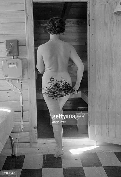 Hazel Mackintosh of Ringmore South Devon stimulates her blood circulation by beating herself with a birch twig in her private sauna