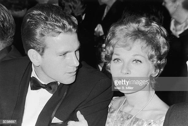 Married American actors Ryan O'Neal and Joanna Moore at a Hollywood event California Moore has her arm wrapped around O'Neal's as he speaks to her