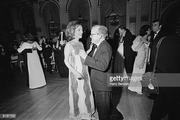 American novelist, Truman Capote , dancing with Jackie Kennedy's sister, Princess Lee Radziwill, at his Black-and-White Ball at the Plaza Hotel, New...