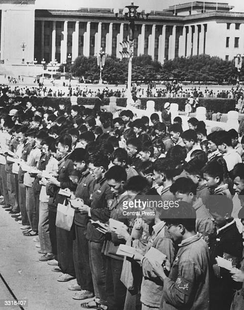 Red Guards reciting in unison as they read from Chairman Mao Tse Tung's works in front of the Cenotaph to the People's heroes in Tiananmen square...