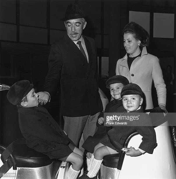 Mexicanborn actor Anthony Quinn with his wife Iolande Adolori and their three sons Franceso Daniele and Lawrence arriving at Los Angeles airport for...